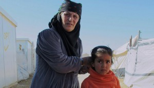 Grandmother Da'ed and her granddaughter Najoua stand in the Za'atari Refugee Camp in Jordan, March 1st, 2015.  (photo by Brenda Stoter)